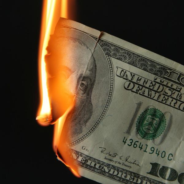 100 dollars burning 700